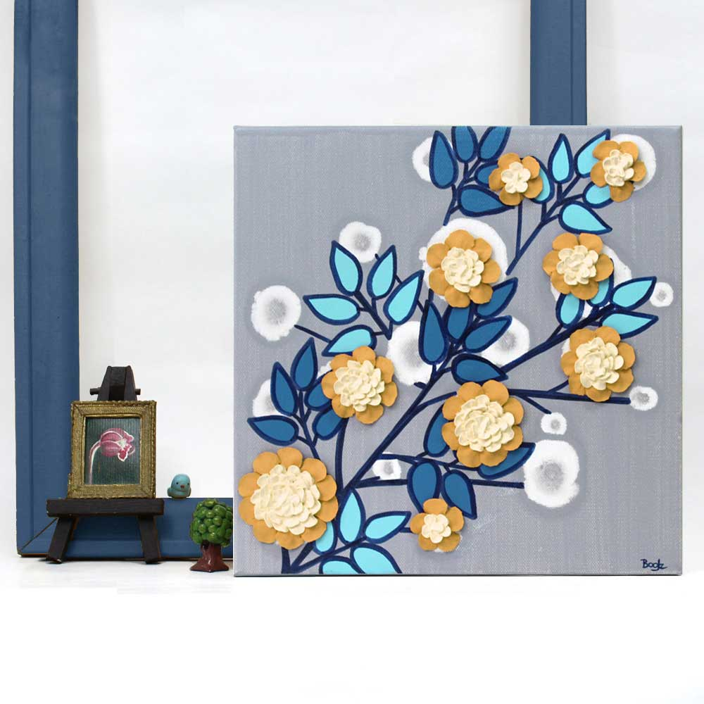 Setting of wall art of flower branch in yellow, aqua, and indigo