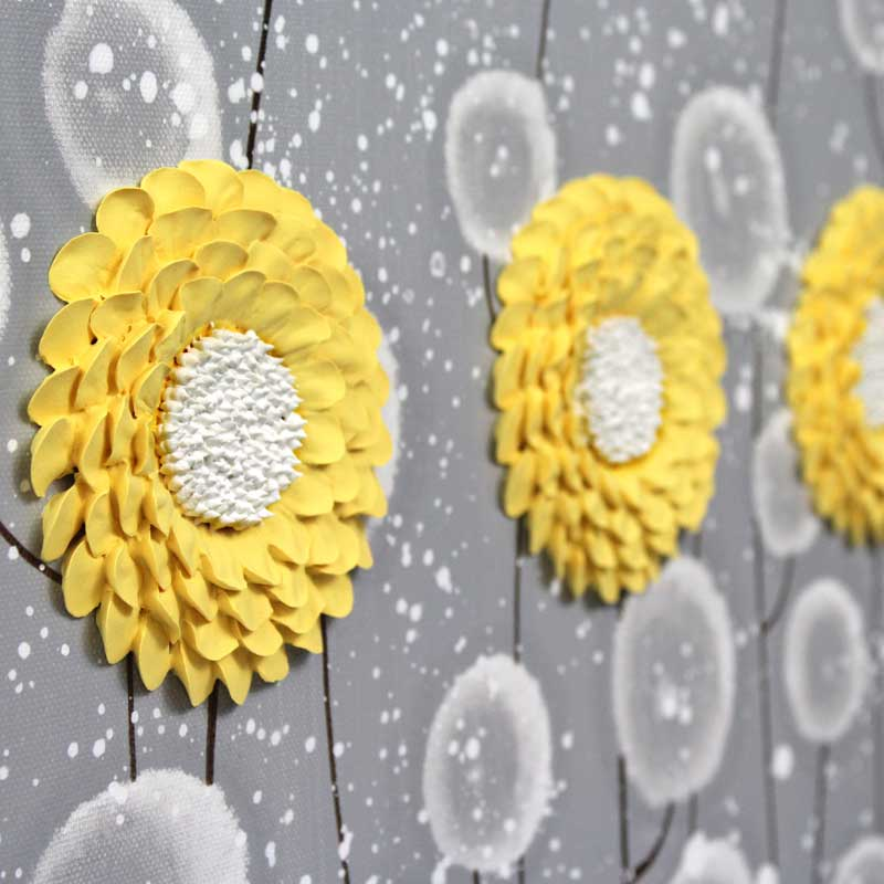Close up of extra large wall art of gray and yellow flowers