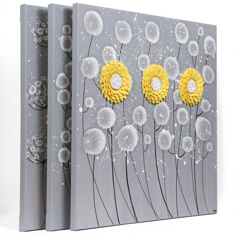 Side view of extra large wall art of gray and yellow flowers