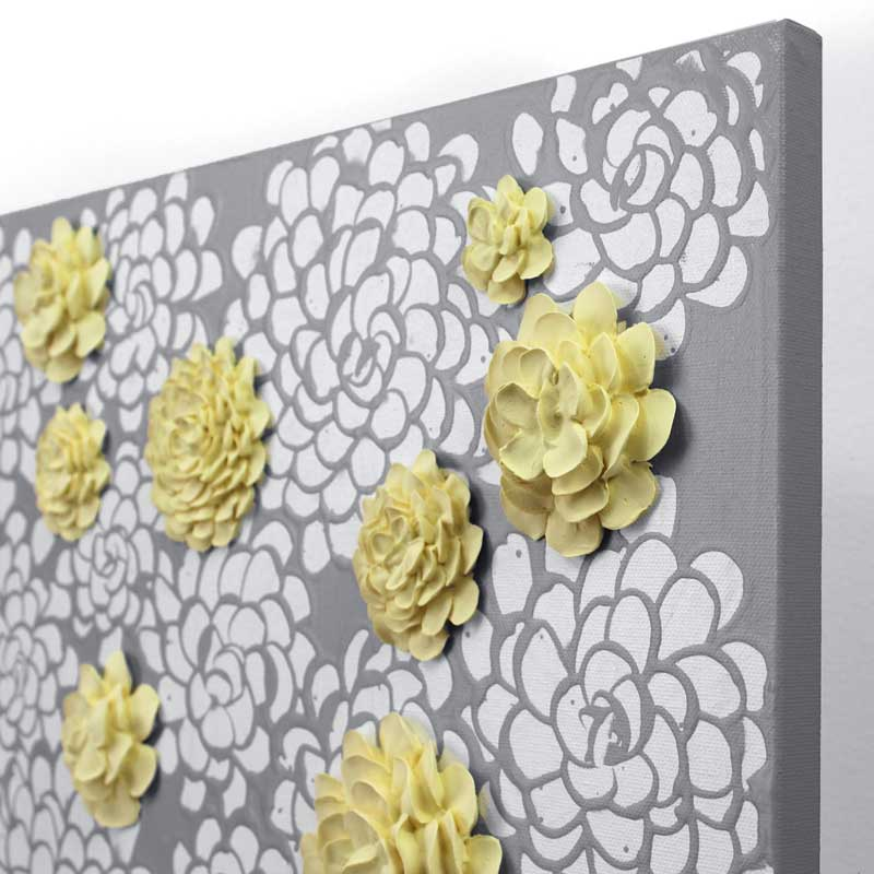 Angle view of wall art gray and yellow dahlia flowers
