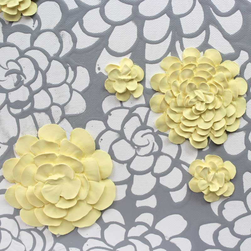 Center view of wall art gray and yellow dahlia flowers