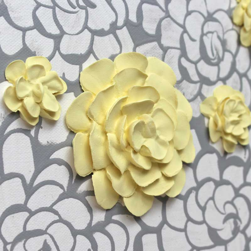 Close up of wall art gray and yellow dahlia flowers