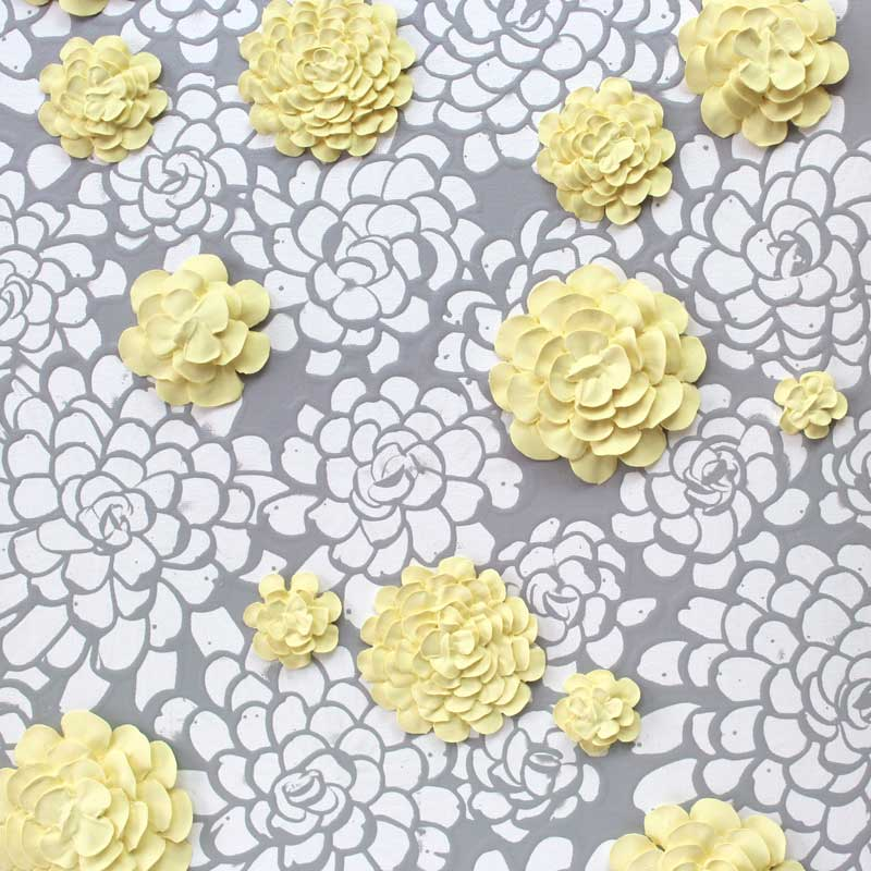 Lacy background of wall art gray and yellow dahlia flowers