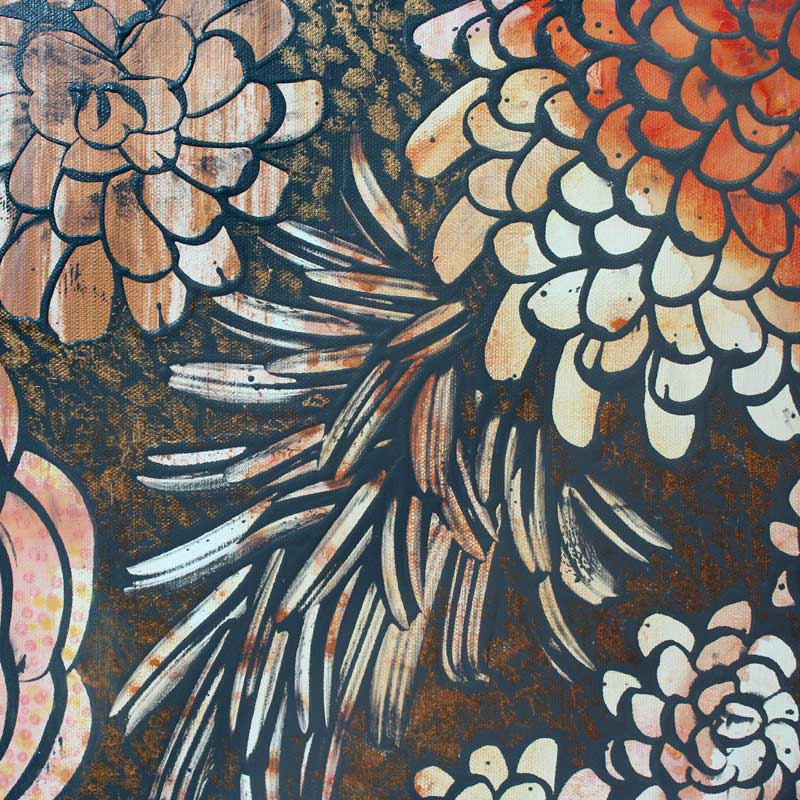 Close up of wall art of tangerine and copper dahlias