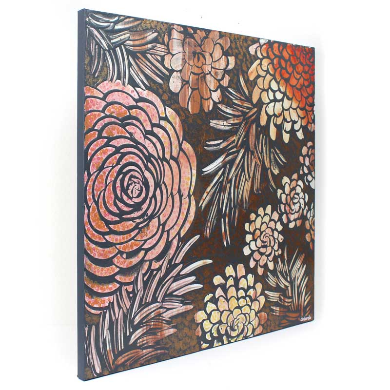 Side view of wall art of tangerine and copper dahlias