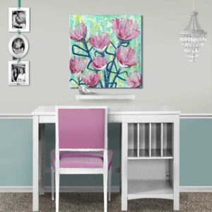 Setting of wall art of spring flowers in pink and blue