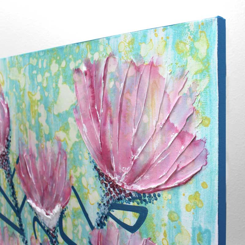 Angle view of wall art of spring flowers in pink and blue