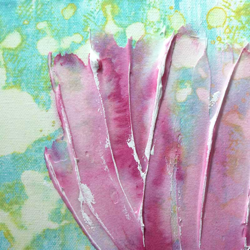 Close up of wall art of spring flowers in pink and blue