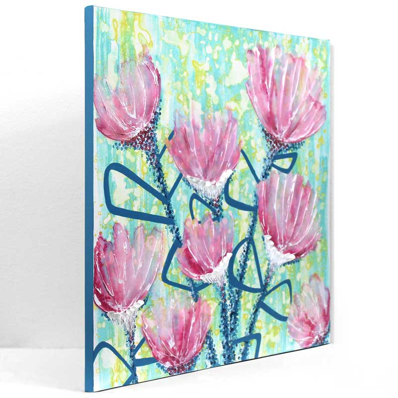 Side view of wall art of spring flowers in pink and blue