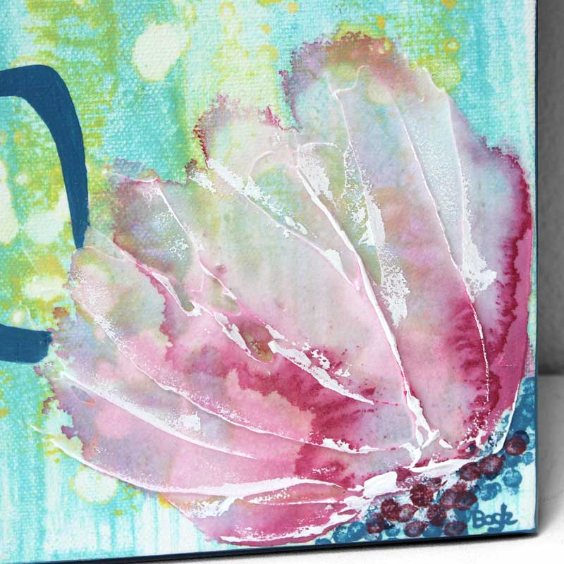 Close up of texture on wall art of spring flowers in pink and blue