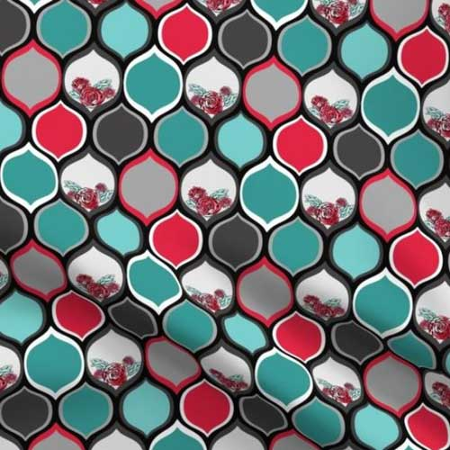 High contrast fabric with black, red, teal ogee pattern