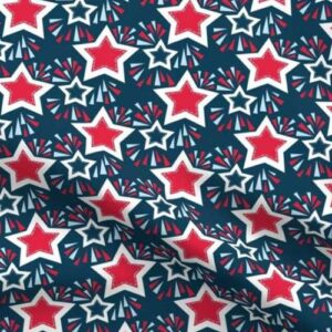 Stars and fireworks on dark blue fabric