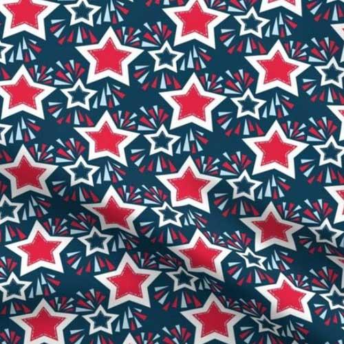 Stars and fireworks on dark blue fabric