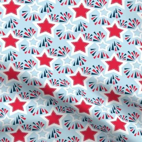 Stars and fireworks on light blue fabric