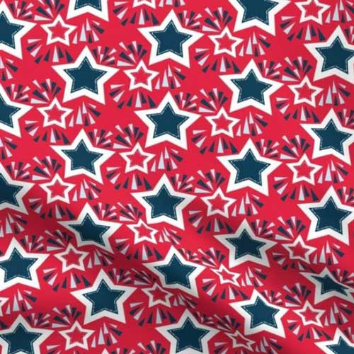 Stars and fireworks on red fabric
