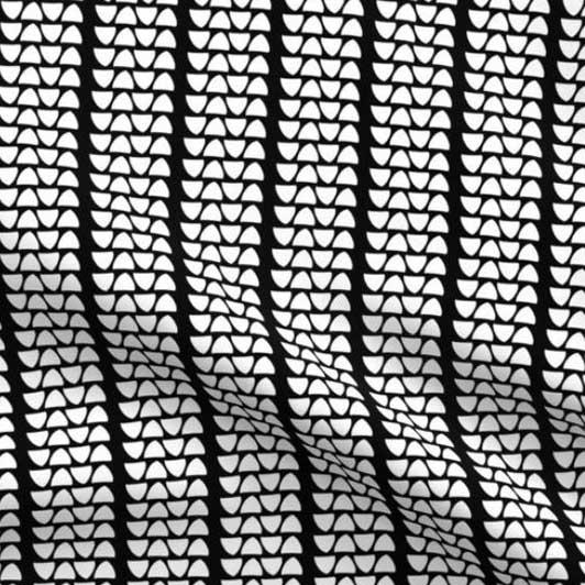 White triangle tread on black fabric