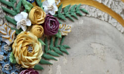 Gold accents on rustic wedding floral art
