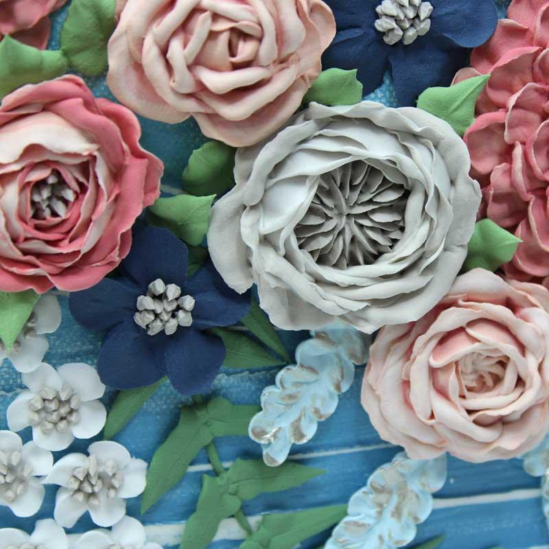 Close up of roses on wedding art blue wave floral