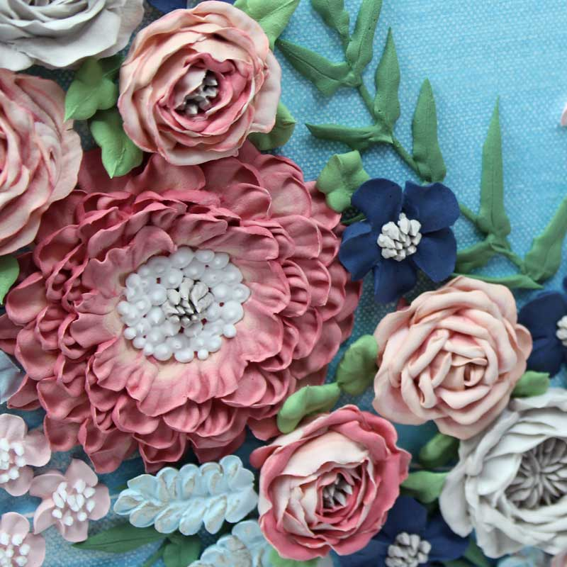 Close up of zinnia on wedding art blue wave floral