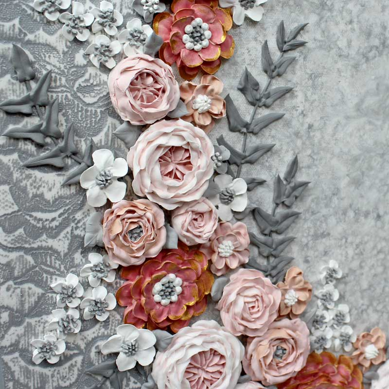 Close up of flowers on pink and gray wedding art