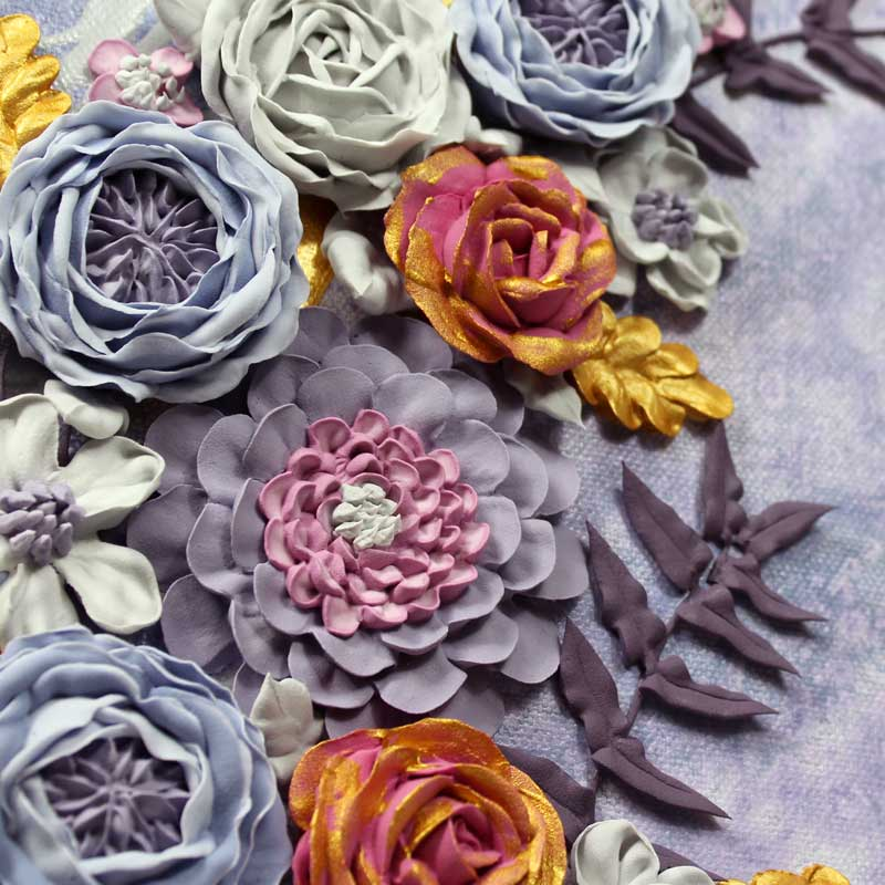 Close up of zinnia on purple and gray floral wedding art