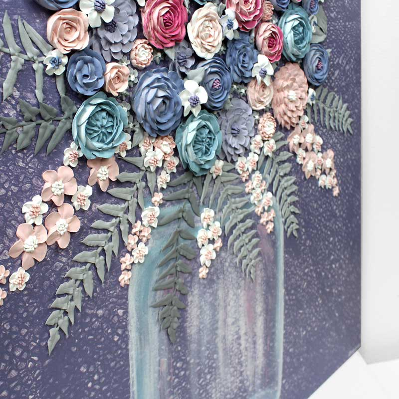 Angle view of textured art with violet farmhouse flower bouquet