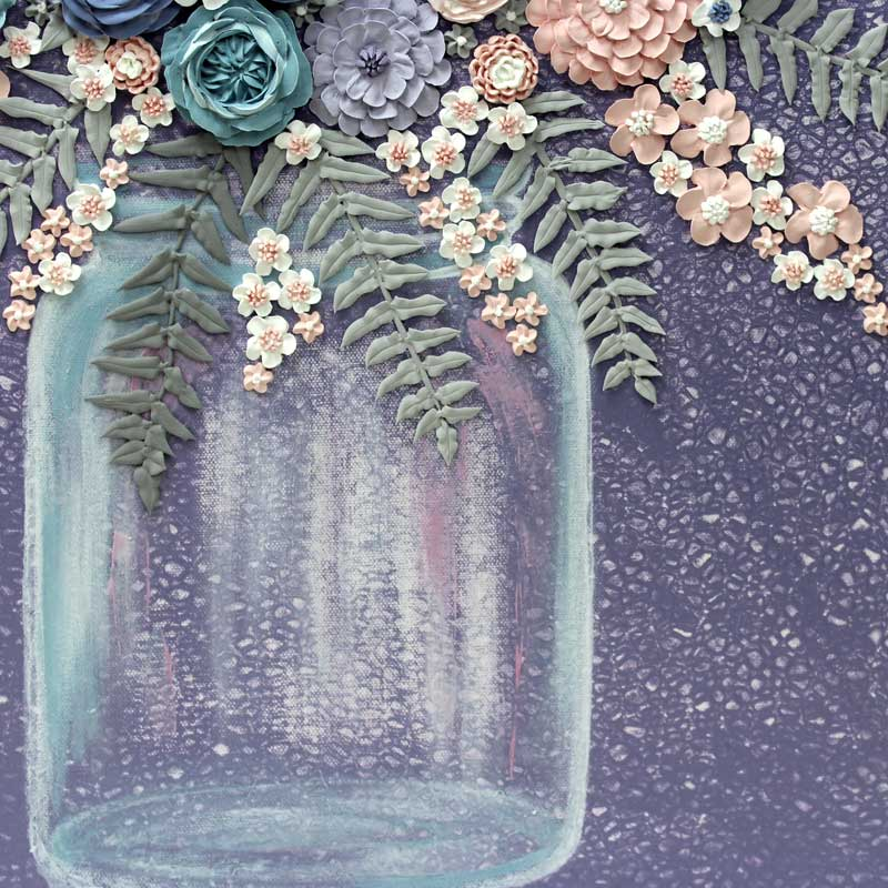 Mason jar on textured art with violet farmhouse flower bouquet