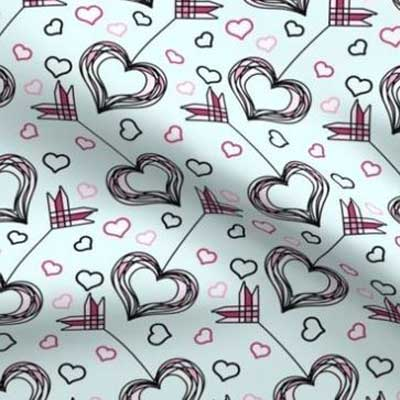 Valentine fabric with pink heart arrows on teal