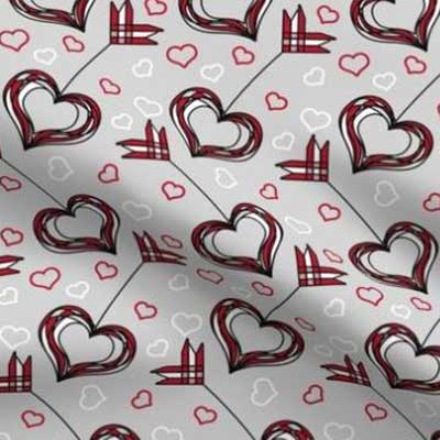 Valentine fabric with red heart arrows on gray