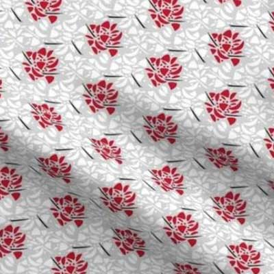 Abstract fabric with red roses on gray
