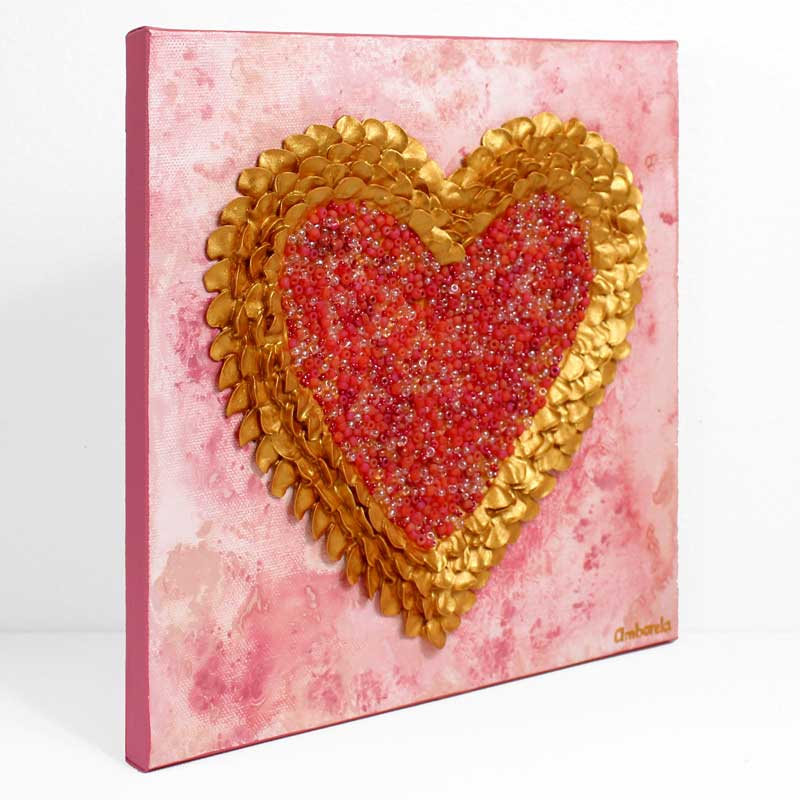 Side view of art of pink and gold sculpted heart